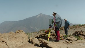 VGG observation at the caldera rim on top of Mt. Guajara (2718 m a.s.l.). In the background is Teide and to the left Pico Viejo with its summit crater. The umbrella is used to shade the meter from the blowing wind.